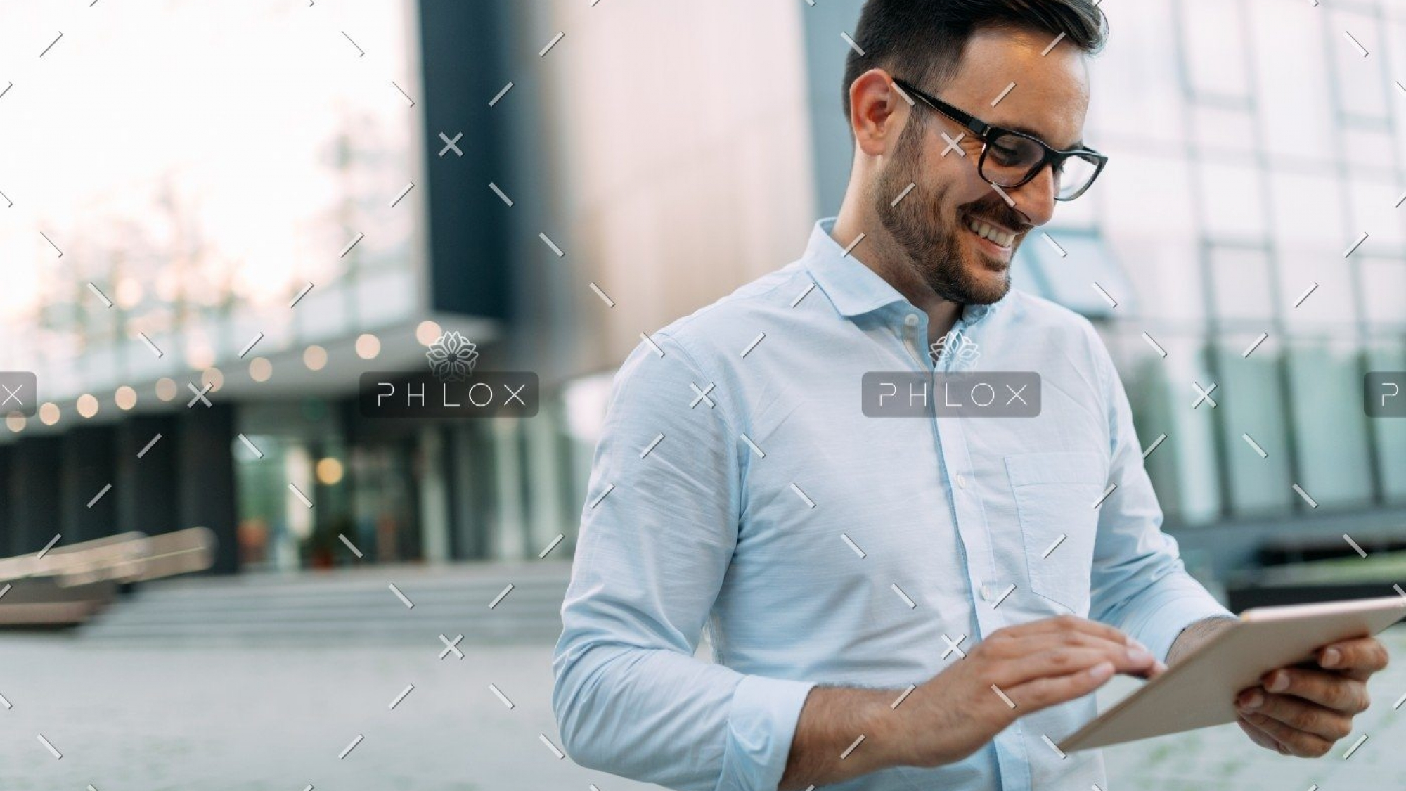 demo-attachment-448-portrait-of-businessman-in-glasses-holding-tablet-AWVHCJU